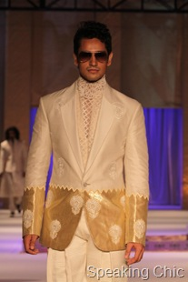 Wihte and gold men's blazer at Rohit Bal couture week