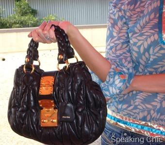 black Miu Miu bag accessory