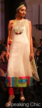 Archana Kochhar white with neon colours kurta-churidar