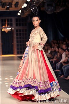 Model in red and purple lehenga Manish Malhotra Delhi Couture Week 2011